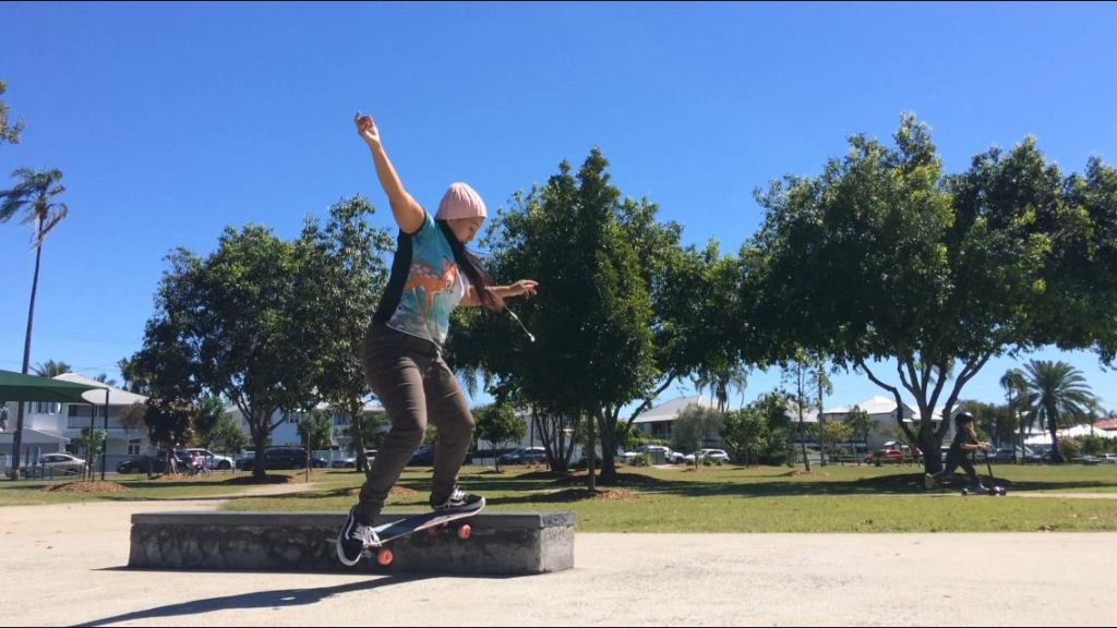 Dr Indigo Willing is skateboarding a ledge doing a trick called a nose slappy with the front part of the skateboard.